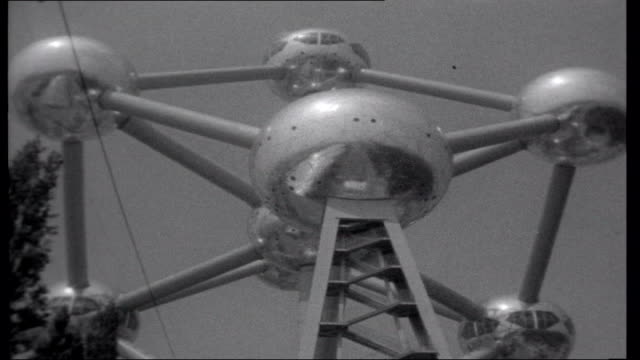 Expo 58 General view of Atomium towering over mock village Air bucket along to Atomium More shots of Atomium ENGLAND Dover Passengers returning from...