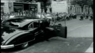 Germany Rearmed Bonn People lining streets watching car carrying British Admiral Pedder with motorcycles escort Pedder out of car as arriving at...