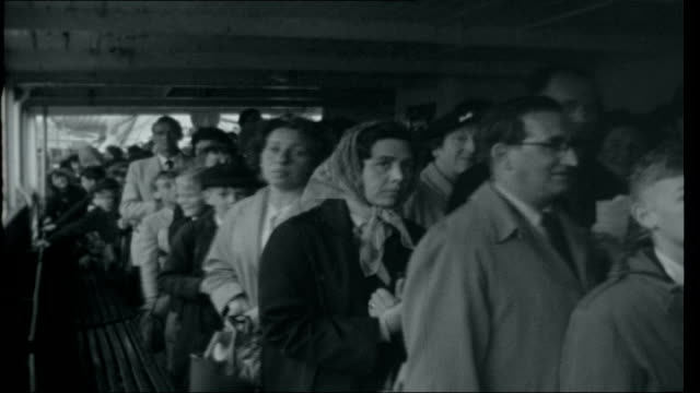 Inflation Boulogne ENGLAND Kent Folkestone Crowds of passengers shuffling along ferry walkway / passengers down gangway and onto quayside / large...