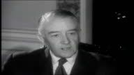 Irish Republic 1961 Barry along and up steps into the Industrial Development Authority building Chairman of the IDA interview SOT talks about exports...
