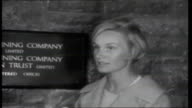 Irish Republic 1961 Reporter to camera and woman interviewed about oil refineries SOT Oil tanker moored at jetty and refined oil piped on board via...