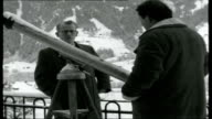 Journey to the Alps Reporter to camera SOT with Eiger mountain behind / views of the Eiger mountain / reporter looking through telescope and...