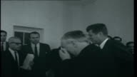 Mr Wilson's Washington Opening titles USA Washington EXT British Labour Party Leader Harold Wilson from car and into the White House / Wilson and...