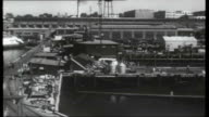 Operation Atlantic USA Connecticut New London Atomic submarine USS Skipjack along on surface / crew members standing on deck as submarine along /...