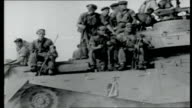 Outlook for Sallal AIR VIEWs HMS Bulwark aircraft carrier at sea/ Royal Navy helicopters and crew on deck British troops and tanks in desert YEMEN...