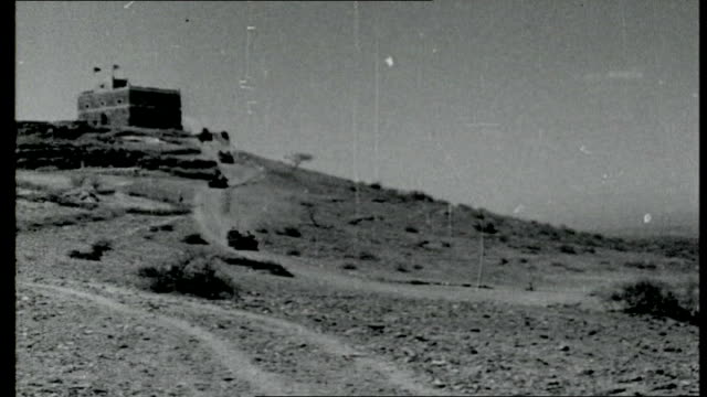 Outlook for Sallal EXT Scrubland area with Federal and British toops keeping watch over the border Aden Aden colony on horizon sea in foreground/...