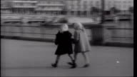 Prince Rainier's Gamble Two girls walking along harbour front Tourists walking along British tourist interview SOT saying he likes climate ambience...