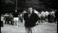 School Without Tears USA Pennsylvania Greeley EXT Young boys congregating in clearing at summer camp as bell rung Reporter to camera Children lined...
