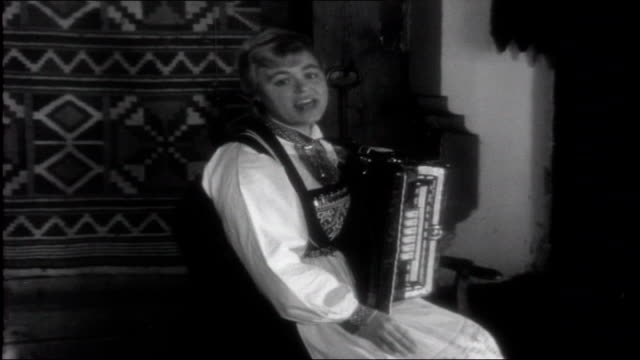 Welcome Winter Marta Nordheim to camera explaining Christmas Elf Nisse story then singing song with accordion accompaniment SOT as seated in front of...