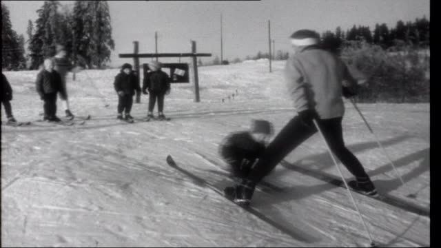 Welcome Winter Tomm Murstad teaching them exercises including bending their knees and jumping into a stride twisting from side to side then skiing...