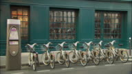 WS Row of bicycles available for rental on street / Paris, France