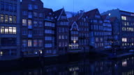 T/L, WS, Row of houses by canal, dusk to night, Nikolaifleet, Hamburg, Germany