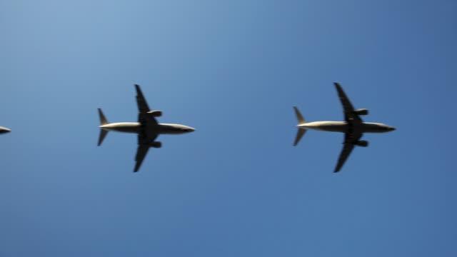 WS LA Row of jets flying against blue sky / Cologne, North Rhine Westphalia, Germany