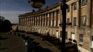 A row of parked cars line the Royal Crescent in Bath England. Available in HD.