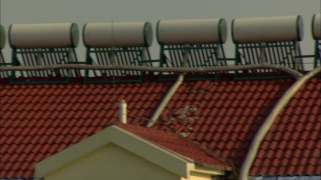 WS PAN Row of solar water heaters on rooftop, Dezhou, Shandong, China