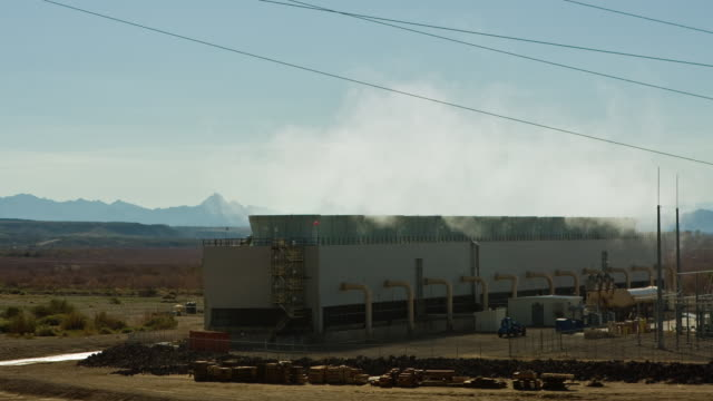 T/L, ZI, MS, Row of steam condenser towers at fossil fueled power plant in desert, Golden Shores, Arizona, USA