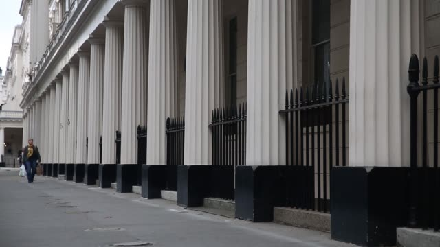 A row of terraced houses stand in Kensington London on Thursday 30th October gvs of the street a pedestrian walks past some grand columns wide of the...