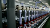 Row of Yarn Machines reeling in factory