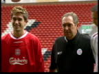 Row over Kewell transfer to Liverpool ITN Liverpool Anfield Harry Kewell posing in Liverpool FC shirt next Liverpool Manager Gerard Houllier as...