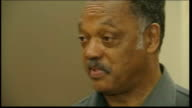 Row over shooting of black teenager Trayvon Martin parents interview / protest rallies continue Rev Jesse Jackson setup shot with reporter /...