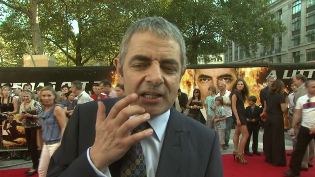 Rowan Atkinson on how he'd like to be more relaxed during shooting at the Johnny English Reborn UK Premiere at London England