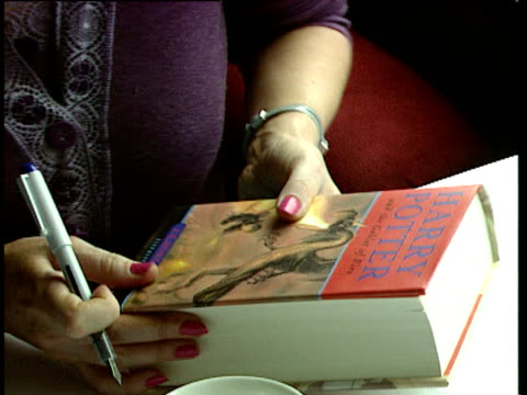 JK Rowling signs copies of her book 'Harry Potter and the Goblet of Fire' onboard replica of Hogwarts Express train England 08 Jul 00