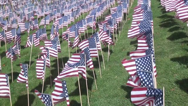 Rows of American flags wave on school field in historic Fort Lee NJ