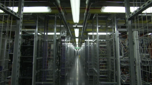 Rows of computers fill a giant server room.