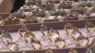 CU, Rows of diamond rings in display window, New York City, New York, USA