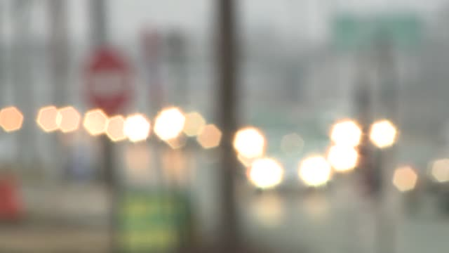 Rows of vehicles driving on a highway headlights on blurred car lights soft focus
