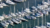 WS AERIAL POV  Rows of yachts moored in marina / Lymington, Hampshire, England