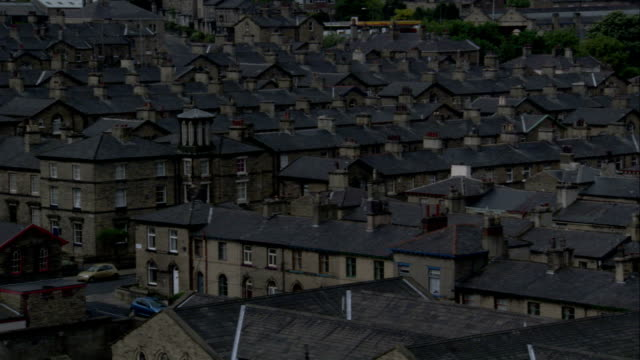 Rows upon rows of terraced houses line the streets of Saltaire village. Available in HD.