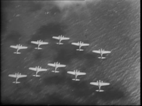 Royal Air Force planes flying in formation / bomber planes dropping in formation / map of the North Sea area between England and Germany / wide view...