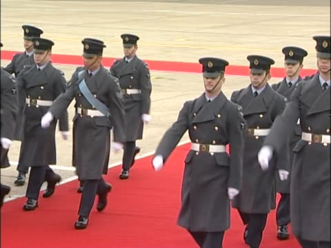 Royal Air Force servicemen parade at Heathrow's VIP suite in preparation for the arrival of Chinese leader Hu Jintao on a state visit