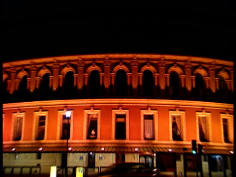 Royal Albert Hall historic multipurpose arts amp sciences building vehicles cars driving across city street FG Urban landmark iconic