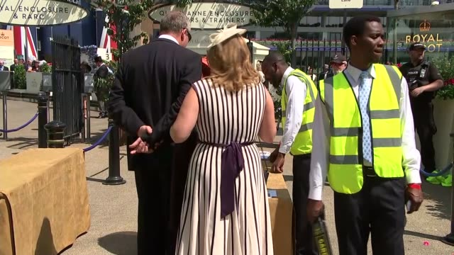 increased security ENGLAND Berkshire Ascot EXT Ascot Races Security / people having picnics / explosives search dog / racegoers along / armed police...