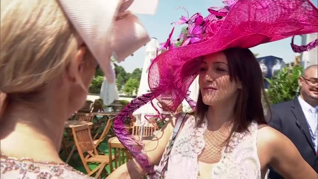 Opening day fashion ENGLAND Berkshire Ascot EXT Woman in pink dress with spectacular fascinator hat / different hats and head dresses / Art...