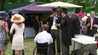 Royal Ascot 2017 Opening day / increased security Racegoers at Royal Ascot Woman smiling as holding drink