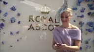 Royal Ascot 2017 Opening day / increased security Woman posing in front of 'Royal Ascot' sign Group of five women posing together