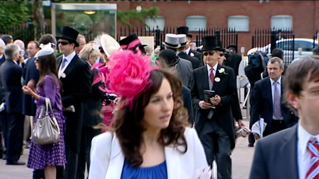 Royal Ascot fashions Various shots of racegoers milling about including women in exotic hats and dresses and men in top hat tails
