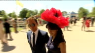 Royal Ascot Ladies Day fashions ENGLAND Berkshire Ascot Racecourse EXT Various shots of women in exotic hats and dresses amongst crowds at Ladies Day...