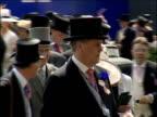 Royal Ascot Royal party / racegoers Horses around parade ring / racegoers along and on terraces around parade ring / racing pundit John McCririck...