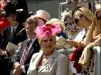 Royal Ascot Royal party / racegoers Racegoers at course standing beneath 'Ascot' sign / well dressed racegoers