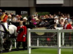 Royal Ascot Royal party / racegoers Royal procession arriving at racecourse to applause led by carriafe carrying Queen Duke of Edinburgh and Prince...