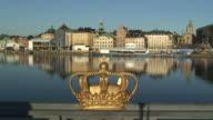 WS Royal crown decoration on Skeppsholmen Bridge with old town in background / Stockholm, Sweden