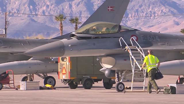 A Royal Danish Air Force F16AM pilot opens the canopy after a mission during Red Flag 142 Mar 7 2014 at Nellis AFB Nev More than 30 countries have...