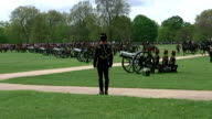 Royal gun salutes celebrate the birth of HRH Charlotte Elizabeth Diana of Cambridge Shows exterior shots King's Troop collecting canons in Hyde Park...