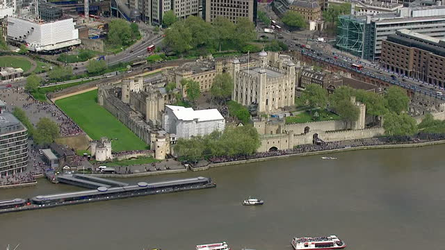 Royal gun salutes celebrate the birth of HRH Charlotte Elizabeth Diana of Cambridge Shows exterior aerial shots the Tower Of London Tower Bridge on...