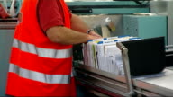 General views of Gatwick Sorting Office ENGLAND Sussex Gatwick INT Royal Mail postal worker at work in sorting office loading and unloading mail into...