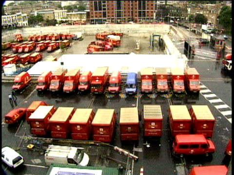 Royal Mail vans and lorries leaving and arriving at depot car park